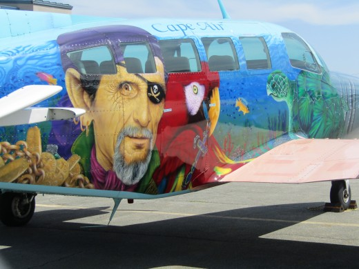 Airplane used for flights between Key West, FL and Hyannis, MA  features a logo of a pirate with his parrot. - Photo by George Sommers