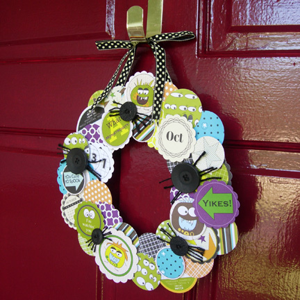 A paper plate wreath and spider scrapbook paper would make this a super cute and easy Halloween paper plate craft project. Hang with some pretty ribbon and add some button spiders!