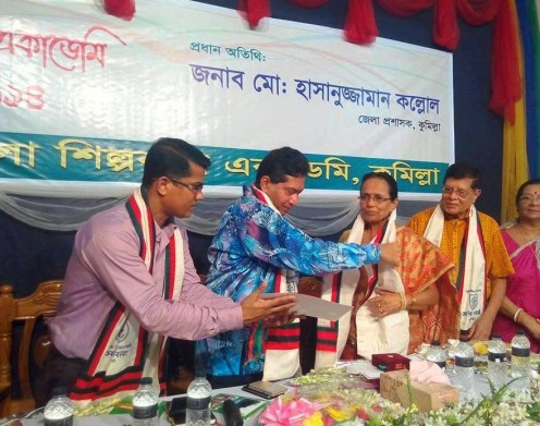 Alaka receiving the Award from the District Counselor of Comilla