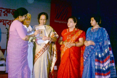 Alaka receiving Nazrul Sangeet Artist Conference Award in National Museum Auditorium, Dhaka