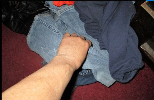 picking clothes off floor - requires a combination of wrist, fingers, bending of back and stooping