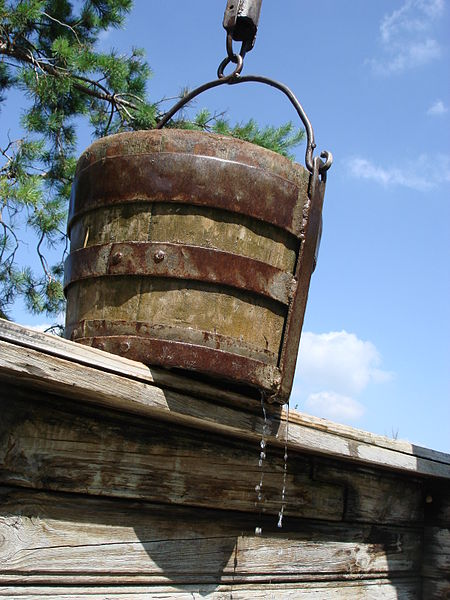 Common, much-used well water bucket.