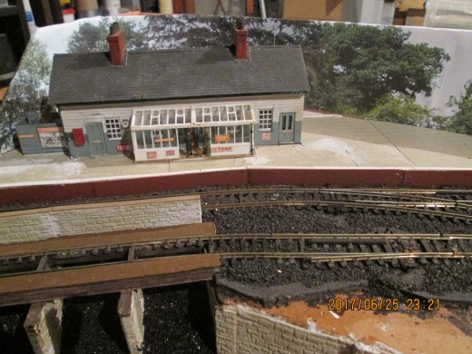 Backscene mounted. I used two, either side of the middle bridge, with suitably wooded themes