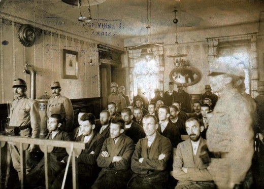 Gavrilo Princip (in the centre of the first row) during his trial, December 1914. Public domain picture
