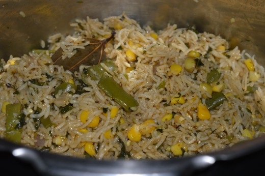 Corn pulao inside the cooker