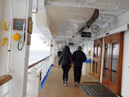 """Walkers on the Caribbean Princess Promenade deck during the """"On Deck for the Cure"""" walk for breast cancer."""