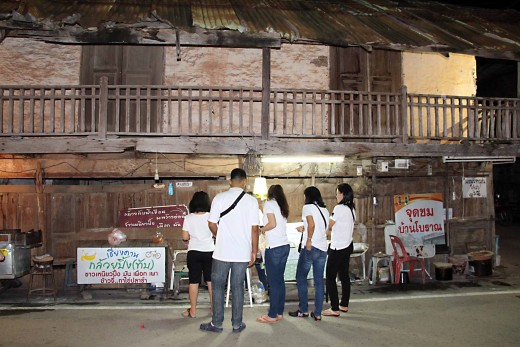 The teak houses of the Walking Street are now home to souvenir stalls