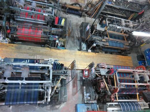 Looms creating Scottish kilts