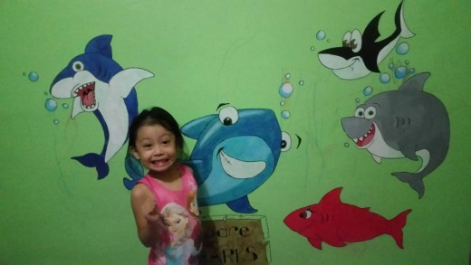 I painted sharks on the wall for her. I also googled the images.