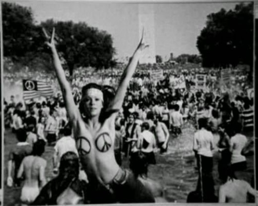 A Woodstock attendee embracing the human body through being nude. A common practice by hippies to show body positivity.