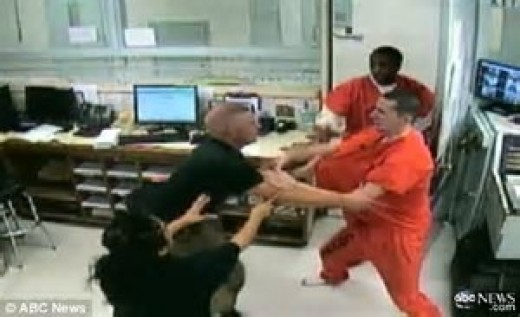 Inmates begin to fight with jail staff even though they cannot win in the end.