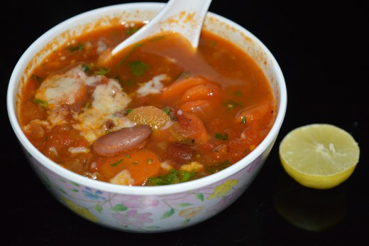 Pour the soup into bowls. Garnish with grated cheese. Drizzle some lemon juice. Enjoy!