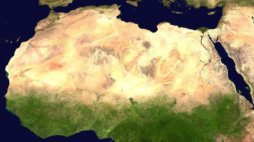 A satellite view of the continent showing the Sahara and green vegetation.