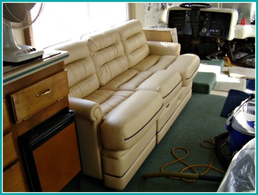 This sofa converts to a bed and also has pull out storage beneath the seat.