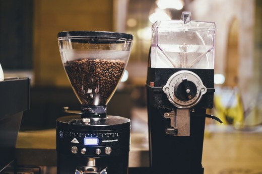 For maximum flavor coffee should always be bought in bean form and ground.  The coarseness of the required grind depends on the type of brewer used.  For instance, a French press uses coarse grounds, whereas an espresso device uses fine.
