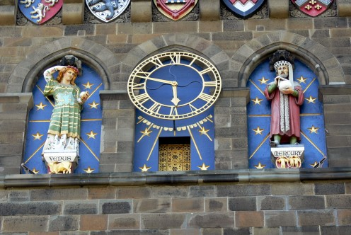 Clock tower (1869) with Venus, goddess of love and fertility, and Mercury, god of commerce and communication.