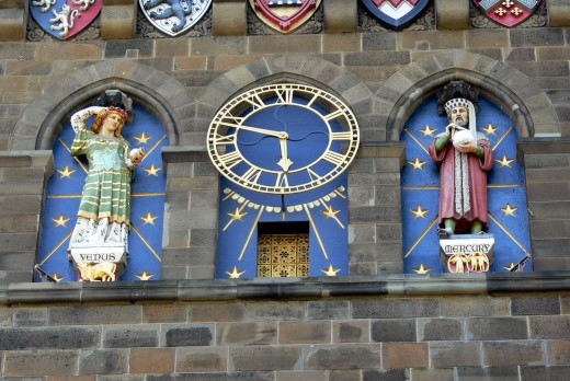 Clock tower (1869) with Venus, goddess of love and fertility, and Mercury, god of commerce and communication. Designed by William Burges.