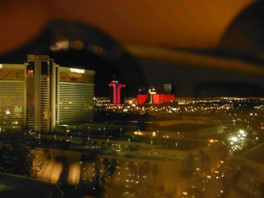 After we got back from the heli tour. The Vegas strip from our window, through my lens. I love how it reflects.