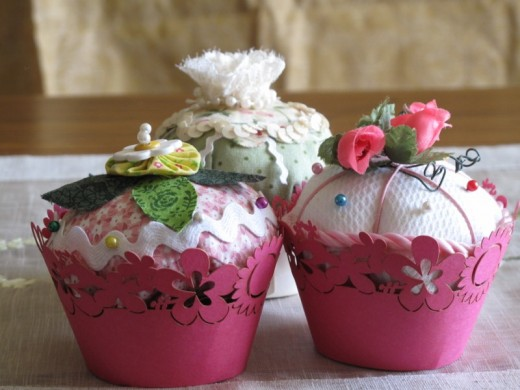 Fabric cupcakes in pink wrappers pincushion designs