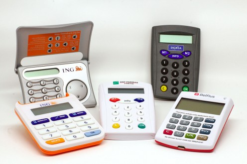 Five models and three different generations of security token devices for online banking. The newer models are in the foreground.