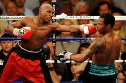 Floyd Mayweather defended the welterweight title by winning a 12 round, unanimous decision over Sugar Shane Mosley.