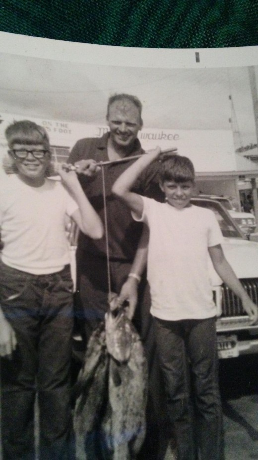 Deep sea fishing with brother, Kim (Deceased) and father, Carl (Also deceased).....and two grouper.