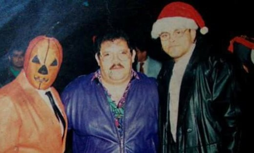 A funny picture of AAA founder Pena, his right hand man Konnan in a Santa hat and luchador Halloween.