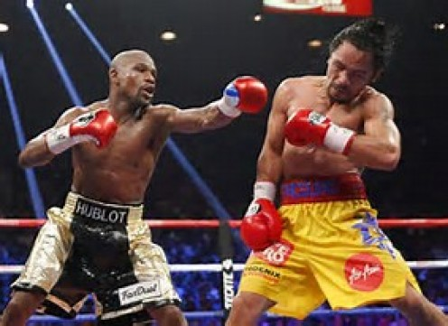 """""""Pretty Boy"""" Floyd won almost every round while winning a 12 round decision over Manny Pacquiao."""