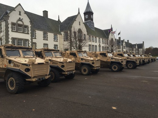 Armoured personnel carriers lined up on the tarmac at Dreghorn Barracks near Edinburgh