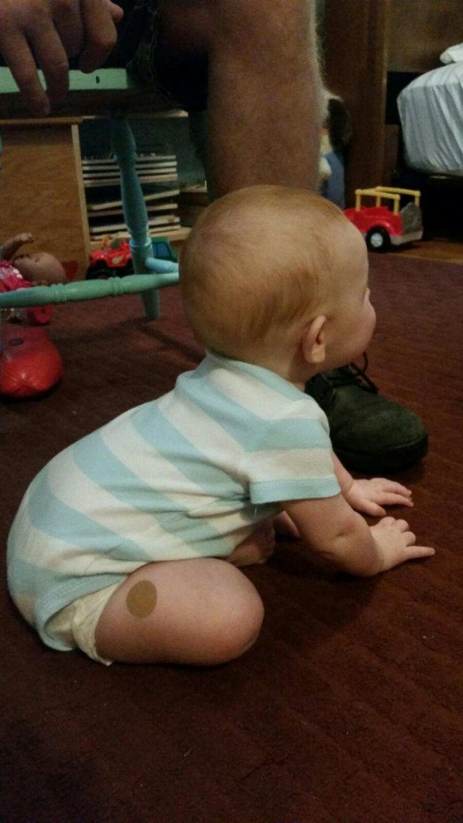 Baby begins sitting in this position, supporting herself with her hands. I encourage her by placing her hands on her thighs and spreading her feet a bit to make a broad, upright base.