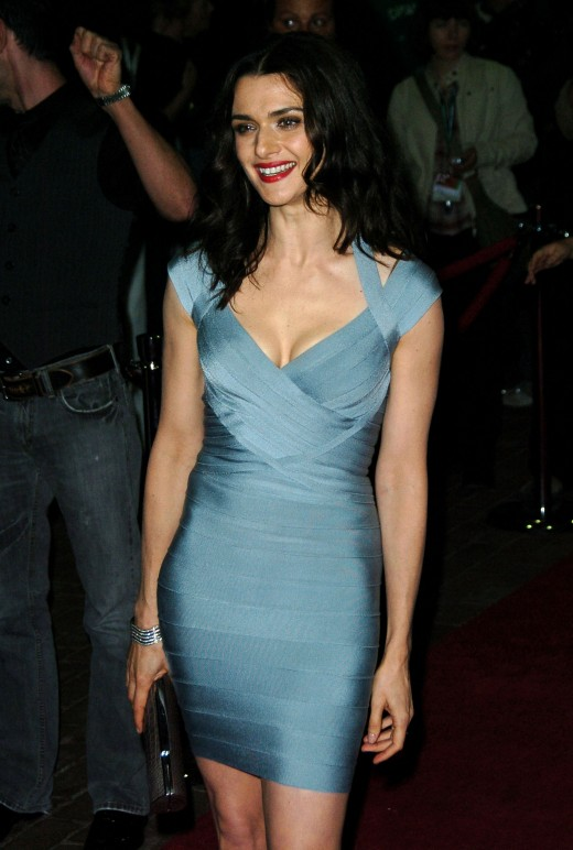 Rachel Weisz wears a shiny powder blue that is both short and tight. It displays a nice amount of cleavage as well.