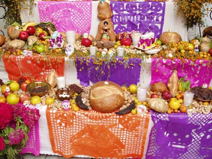 Pan de Muerto (Bread of the Dead) on an Ofrenda