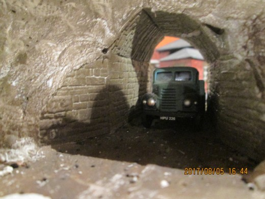 A coal flatbed lorry approaches the coal depot through the underpass