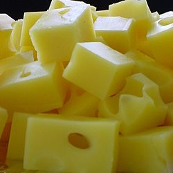 """Swiss cheese is from Switzerland, and has holes in it, the bigger the """"eyes"""" the more rich the flavor"""