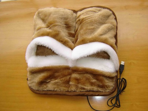 USB heated plush uni-slipper. Great for people with cold feet.
