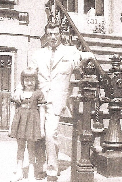 Daddy and me.  Taken by my sister Valerie, with one of those box cameras, probably the spring or summer before the Christmas of the falling tree occurred!