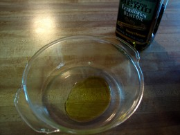 Add about 3T of olive oil to the dish and coat the sides of the dish with this oil real good.