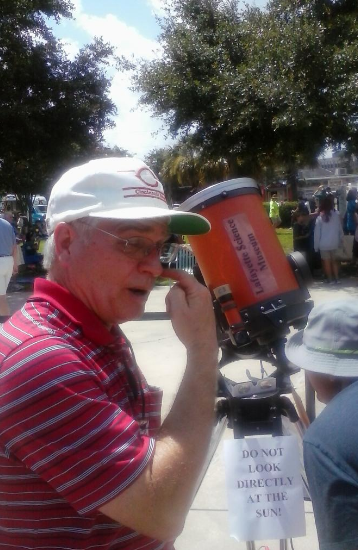 David Hofstetter demonstrates the use of a solar telescope.