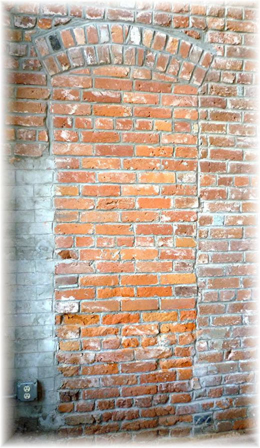 Bricked in doorway that used to be a conduit between a hardware store and a brothel next door.