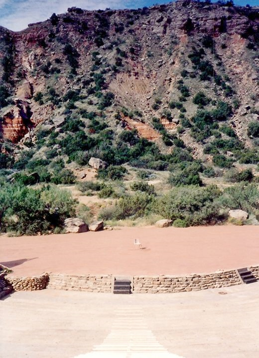 Seating, stage and dramatic backdrop at Pioneer Amphitheater in Palo Duro Canyon.