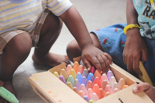 Drawing pictures using colored chalks engage a child's motor and creative abilities.