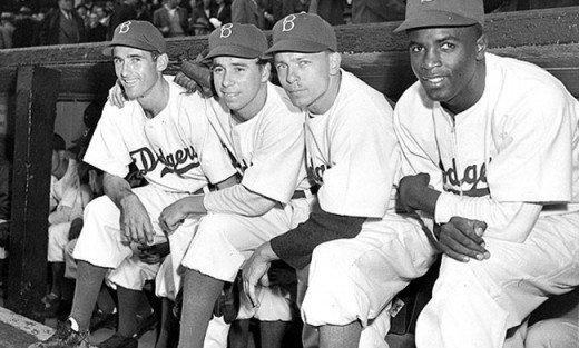 Tokenism goes back a long ways.  Jackie Robinson broke the glass ceiling for baseball, but was often times presented in media to bury the idea that America was a racist country.  This picture shows otherwise.