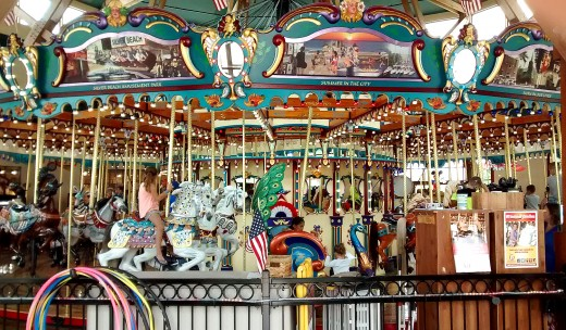 The Silver Beach Carousel has 44 colorful, hand-crafted horses in a setting by the beach and fountain.