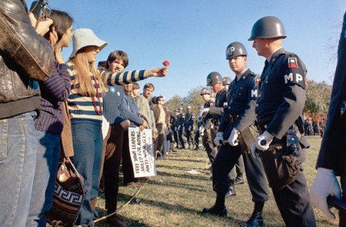 Hippy girl offers officer to flower at Anti War Protest at Pentagon. Such protests were pretty much a normal part of the 1960s.