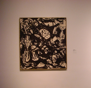 This Jackson Pollack, perfectly paired with a simple black frame, would  suit your modern living room.