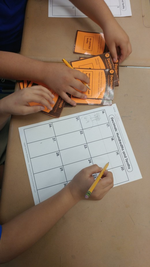 Here my students are working together during workstation rotations. They have a recording sheet to document their work.