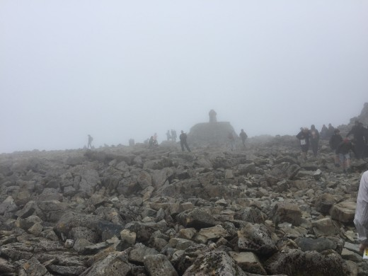 The summit trig point within view. It's a shame there is cloud cover and the vistas are obscured but at least we can see where we are putting our feet. It is quite cold here now and we have all put on top layers.