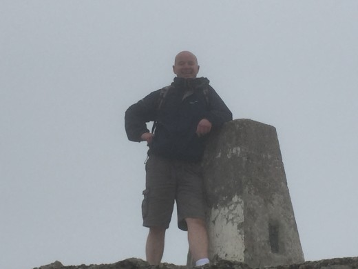 Another of Rob at the summit trig point.