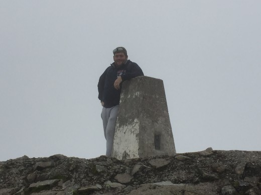 Another photo of Steve at the summit trig point.