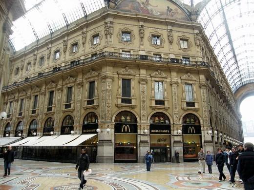 Shows the mosaics on the floor inside the Galleria Vittorio Emanuele II.